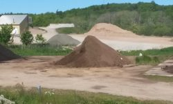 Compost & topsoil piles – cropped